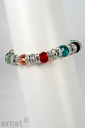 elastic bracelet with rhinestones and  facetted coloured glassbeads with casting elements, nickel tested